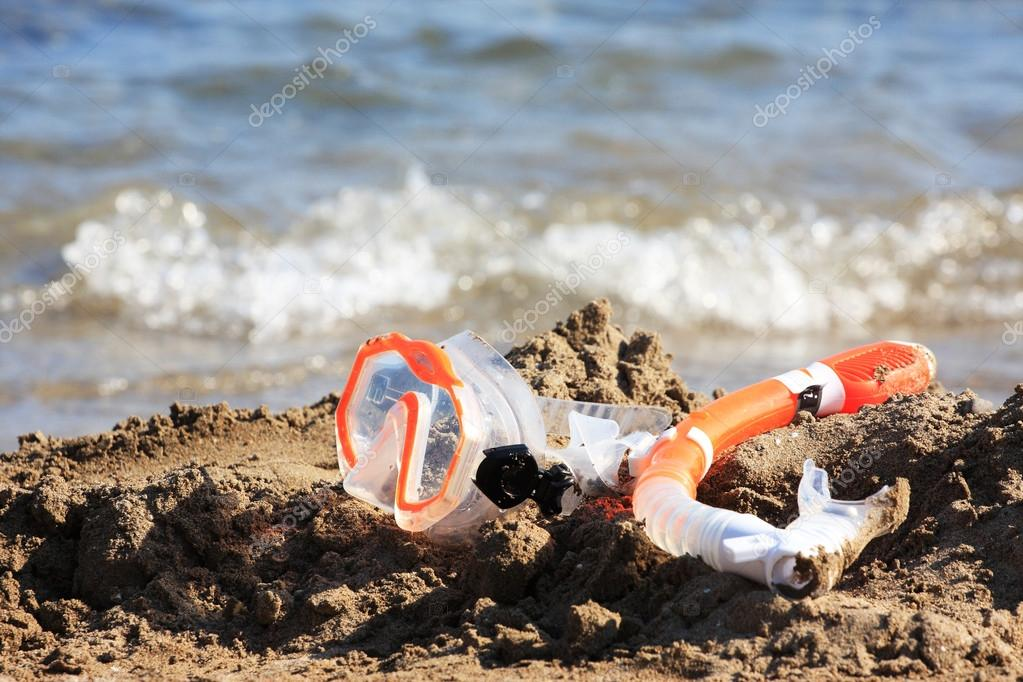 Mask and tube on sandy beach — Stock Photo #12316474