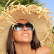 Beauty portrait of woman on the beach wearing straw hat — Stock Photo #12462865