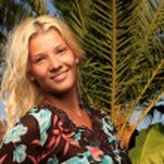 Young woman at tropical resort — Stock Photo #12463777