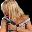 Topless girl holding guns — Stock Photo