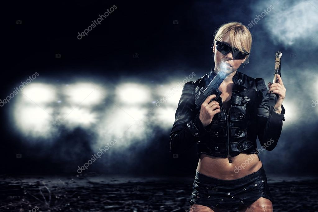 Special  tactics sexy woman holding up her weapon — Stock Photo #13507289