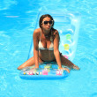 Woman Relaxing in a pool — Stock Photo #13510737