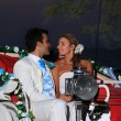 Beach wedding: bride and groom on a carriage - Stock Photo