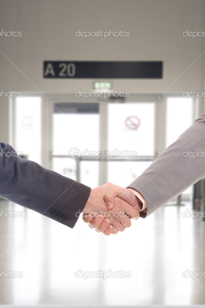 Businessman handshake at corporate entrance — Stock Photo #14718181