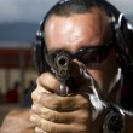 Man shooting on an outdoor shooting range — Stock Photo #14721815