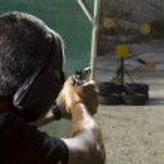 Man shooting on an outdoor shooting range — Stock Photo #14721901