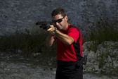 Man shooting on an outdoor shooting range — Stock Photo