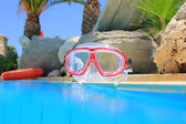 Scuba mask at poolside — Stock Photo