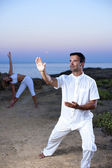 Young couple practicing yoga and Tai Chi — Stock Photo