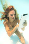 Woman using a tablet PC underwater — Stock Photo