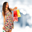 A shot of a woman shopping outdoor — Stock Photo