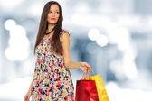 A shot of a woman shopping outdoor — ストック写真