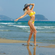 Foto Stock: Woman on the beach