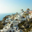 Oia in Santorini with Windmill - Stock Photo