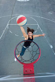Young basketball player going to the hoop. — Stock Photo