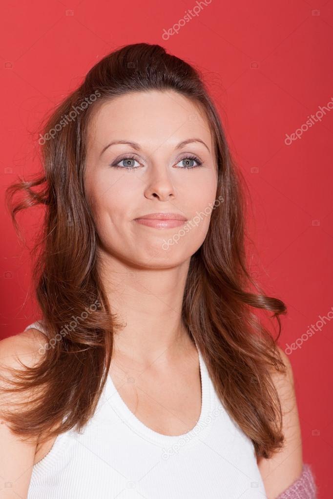 Sophisticated woman posing over red background — Stock Photo #15798865