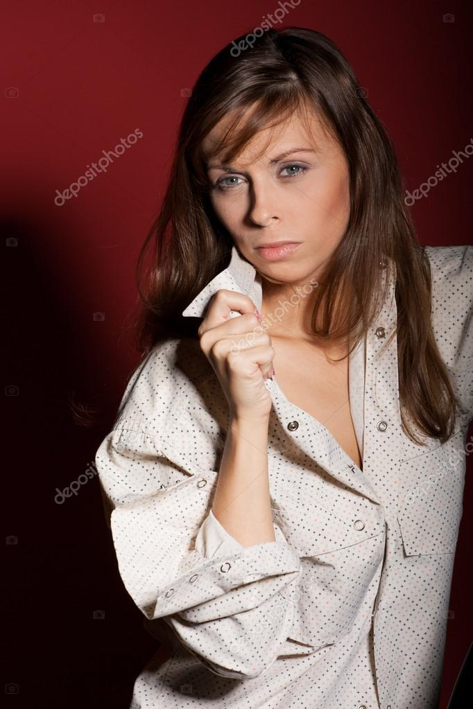 Sophisticated woman posing over red background  Stock Photo #15798871