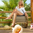 Foto Stock: Woman relaxing at summer resort
