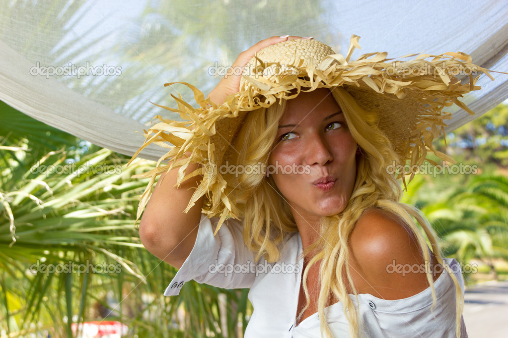Young blonde woman relaxing at summer resort  Stock Photo #16056935
