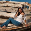 Mature model posing at shipwreck - Stock Photo