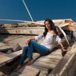 Mature model posing at shipwreck — Stock Photo