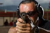 Man shooting on an outdoor shooting range — Stock Photo