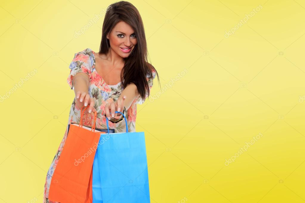 A shot of a woman with bags shopping outdoor — Stock Photo #16903053