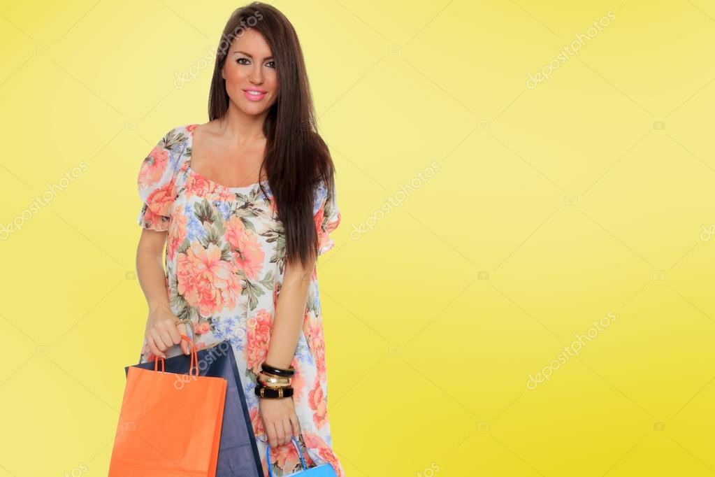 A shot of a woman with bags shopping outdoor — Stock Photo #16903065
