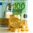 Stock Photo: Euro money box with gold coins