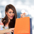 A shot of a woman shopping outdoor - Photo