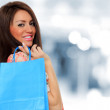 A shot of a woman shopping outdoor - Foto de Stock