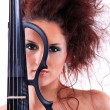 Royalty-Free Stock Photo: Attractive violinist playing the electric violin