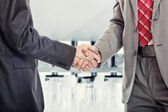 Business man handshake at the office — Stock Photo