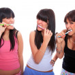 Happy Young Women Brushing their Teeth - Stock Photo