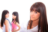 Three attractive girls gossiping — Stockfoto