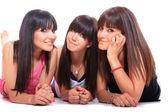 Group of three girls laying — Stock Photo