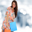 A shot of a woman shopping outdoor — Stockfoto