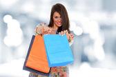 A shot of a woman shopping outdoor — Stock Photo