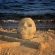 Sand skull and bones - Stock Photo