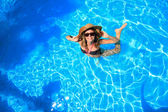 Woman in a swimming pool in Greece — Stock Photo