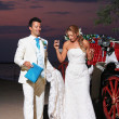 Beach wedding: bride and groom - Stock Photo