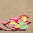 Flip flop sandals at the beach — Stok fotoğraf