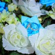 Two Wedding Rings on flowers - Stock Photo