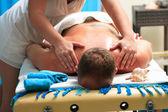 Handsome man getting massage — Stock Photo