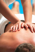 Handsome man getting massage — Stock Photo