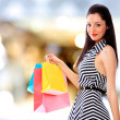 Attractive young girl with shopping bags - Foto Stock