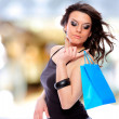 Attractive young girl with shopping bags - Foto de Stock
