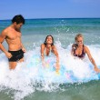 On the beach having lots of fun in their vacation — Stock Photo #18607515