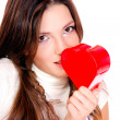 Royalty-Free Stock Photo: Young woman holding a red heart