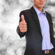 Business man posing over abstract background — Stockfoto